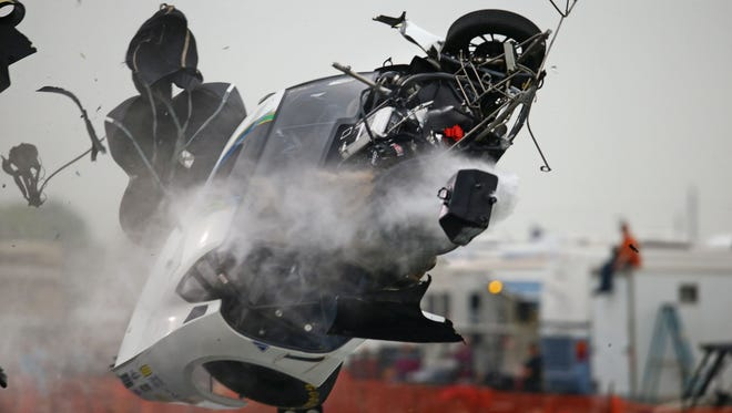 NHRA  pro mod driver Sidnei Frigo flies through the air as he crashes during qualifying for the Spring Nationals at Royal Purple Raceway. Frigo was alert and transported via helicopter to a hospital.