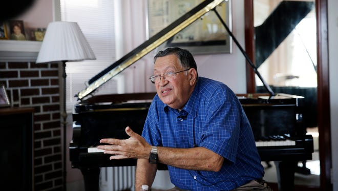 Piano tuner Charlie Birnbaum of Hammonton, N.J., sits near a grand piano in the three-story house where he was raised in Atlantic City, N.J. New Jersey Superior Court Judge Julio Mendez ruled Friday, Aug. 5, 2016, that the Casino Reinvestment Development Authority's yearslong effort to condemn the house to assemble land for a tourism district is an abuse of eminent domain power and exceeds the agency's authority.