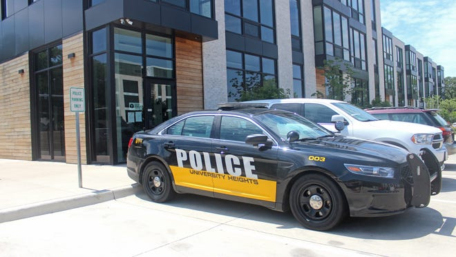 A police car sits outside the University Heights Police Department on July 13, 2017.