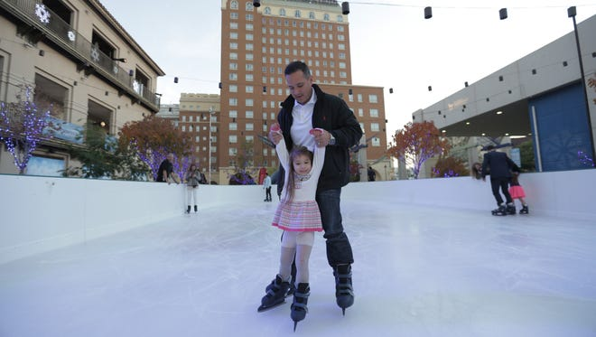 A girl learns to ice skate at WinterFest in 2016.