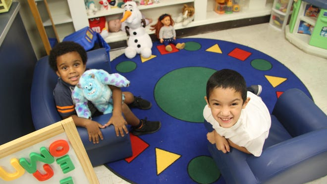 Elijah Adeniyan and Rio Gomez, both 4 years old, enjoy the new classrooms at Hillcrest Preschool Friday, Jan. 12, 2018. Hillcrest was formerly an elementary school that closed in summer 2016 after the opening of Ocotillo Elementary School.