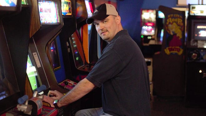 Ken Kalada, owner of YESTERcades in Somerville and Red Bank, is pictured at his childhood favorite video game, Arkanoid. YESTERcades will open a third location mid-spring in Westfield.