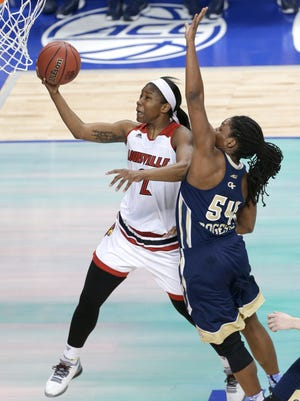 Louisville's Myisha Hines-Allen (2) shoots past Georgia Tech's Roddreka Rogers (54) during the first half of an NCAA college basketball game in the Atlantic Coast Conference tournament in Greensboro, N.C., Friday, March 4, 2016. (AP Photo/Chuck Burton)