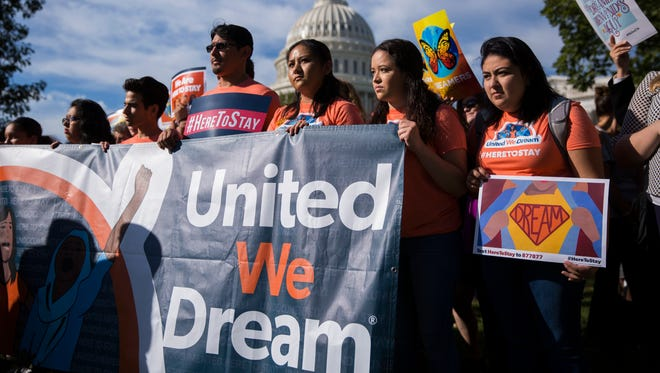 Protesters chant slogans during a news conference with DACA recipients and pro-immigrant advocacy groups to demand passage of a 'Clean Dream Act', at the US Capitol in Washington, D.C. Oct. 5, 2017. The DREAM Act would allow for lawful permanent residence to DREAMers and offer a path to citizenship.