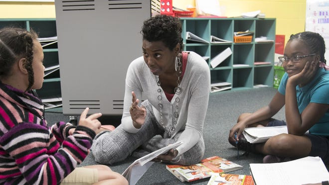 Tamara Joy Hunter works with Arianna Thompson, left, and Serenity Jackson, right, during class on Wednesday at Franklin Park Magnet School in Fort Myers.