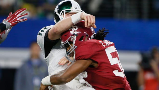 Michigan State QB Connor Cook is tackled by Alabama's Tim Williams during the second half of MSU's loss in the Cotton Bowl Thursday in Arlington, Texas.