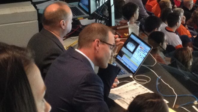 Dan Bylsma takes notes during the RIT-Boston College game on Saturday
