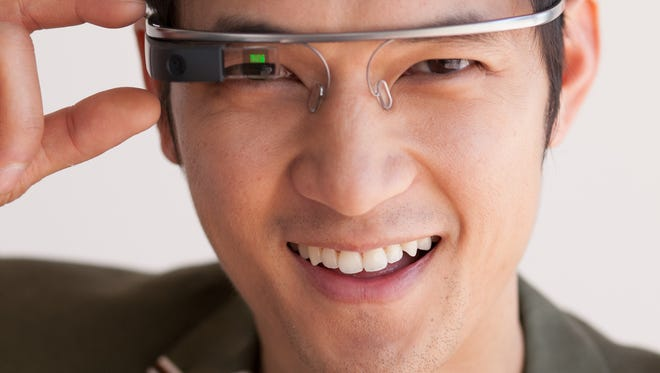 Actor Harry Shum, Jr. with his Google Glass. Google Glass is a wearable computer with an optical head-mounted display (OHMD) which displays information in a smartphone-like hands-free format. It will be available for a limited time to the American public on April 15, 2014.