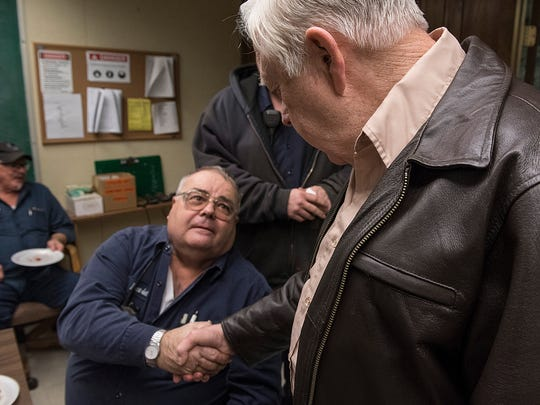 Jack Hollon, retiring after 60 years, shakes hands