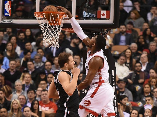 Jason Thompson (right), a former Lenape and Rider star, dunks the ball in a game with the Toronto Raptors in the 2015-16 NBA season. Thompson spent seven seasons with the Sacramento Kings, then part of the 2015-16 season with the Golden State Warriors and Raptors.
