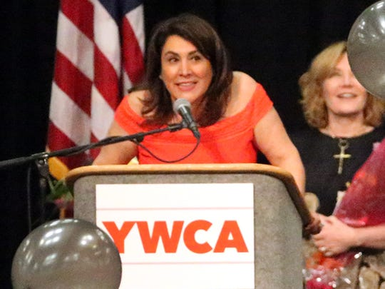 Balloons fall from the rafters as Sylvia Acosta, CEO of the YWCA El Paso del Norte Region, speaks Thursday at the end of the group's 25th annual Women's Luncheon.