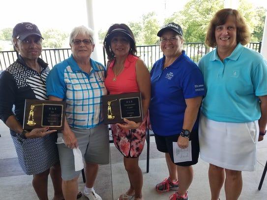 From left are O&E Women's Open winners Cynthia Pickard,
