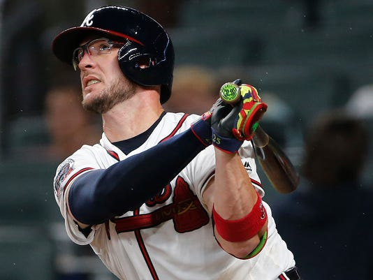 Atlanta Braves' Tyler Flowers (25) watches his solo home run during the seventh inning of the team's baseball game against the San Francisco Giants on Wednesday, June 21, 2017, in Atlanta. Atlanta won 5-3 in 11 innings. (AP Photo/John Bazemore)