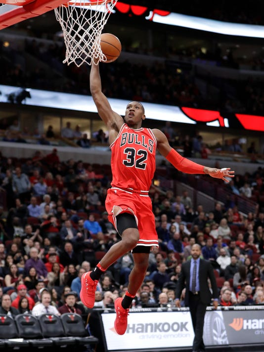 Chicago Bulls' Kris Dunn goes up for a dunk during the second half of an NBA basketball game against the Memphis Grizzlies Wednesday, March 7, 2018, in Chicago. The Bulls won 119-110. (AP Photo/Charles Rex Arbogast)