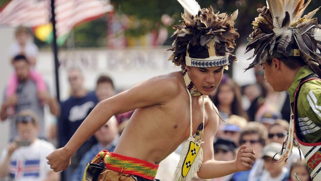 File - Longhouse dancers Brandon Grandquist, center, and Jojo Santiago, both of Oneida, perform Native American dances at the 23rd annual Ethnic Fest celebration in Two Rivers in 2014.