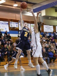 Hartland's Syd Caddell goes in for a layup during a