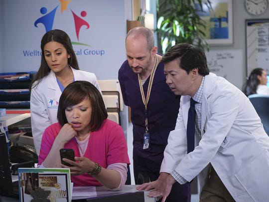 "In this image released by ABC, Kate Simses, from left, Tisha Campbell-Martin, Jonathan Slavin and Ken Jeong appear in a scene from ""Dr. Ken,"" premiering Oct. 2 on ABC. (Danny Feld/ABC via AP)"