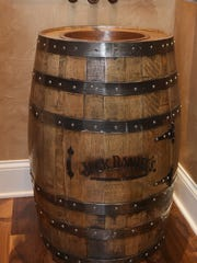 The powder room in the home built by Wiesner Homes has a sink made from a Jack Daniel's barrel.
