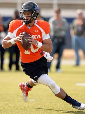 South Squad quarterback Jimmy Garoppolo of Eastern Illinois (10) rolls out to pass during practice at Fairhope Municipal Stadium.