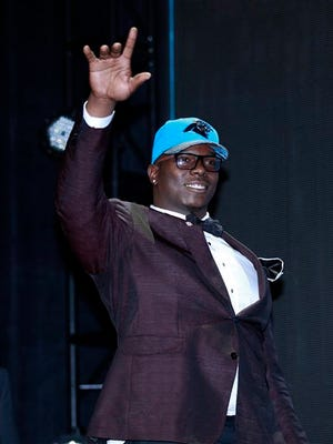 Louisiana Tech's Vernon Butler walks on the stage after being selected by the Carolina Panthers as the 30th pick in the first round of the 2016 NFL football draft, Thursday, April 28, 2016, in Chicago.  (Jeff Haynes/AP Images for Panini)
