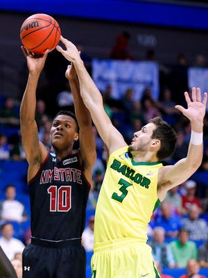 New Mexico State's Jemerrio Jones (10) attempts a shot as Baylor 's Jake Lindsey (3) defends in the first half of a first-round game in the men's NCAA college basketball tournament in Tulsa, Okla., Friday March 17, 2017. (AP Photo/Tony Gutierrez)