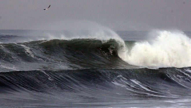 Waves roll ashore at the beach at El Segundo, Calif., Sunday, Dec. 21, 2014. The National Weather Service said the high surf was delivered by a large northwest swell. (AP Photo./John Antczak)