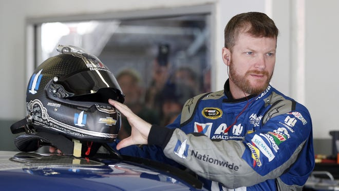 Dale Earnhardt Jr. prepares to climb into his car during practice Friday for Sunday's NASCAR Daytona 500.