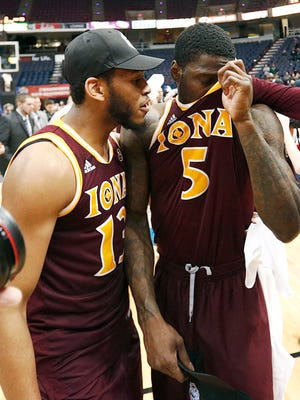Iona Gaels guard Jahaad Proctor (13) and guard A.J. English (5) celebrate after defeating the Monmouth Hawks in the MAAC conference tournament finals at Times Union Center.