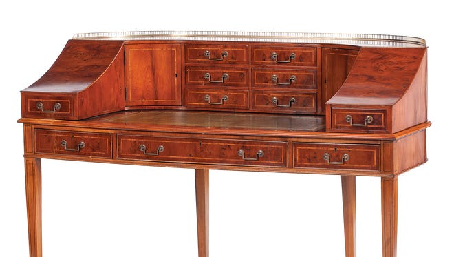 The original Carlton House desk was ordered for an 18th-century building in London. This is a 20th-century copy that recently auctioned for $660.
