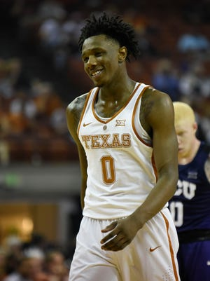 Texas Longhorns guard Tevin Mack (0) reacts against the Texas Christian Horned Frogs during the first half at the Frank Erwin Center.