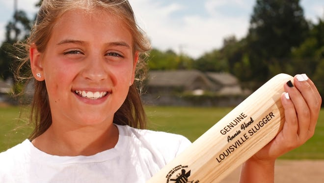 Annie Flood, an 11-year-old from Salem, participated in the Wounded Warrior Amputee Softball Team Kids Camp June 13 in Louisville, Ky. Photographed at North Salem High on Tuesday.