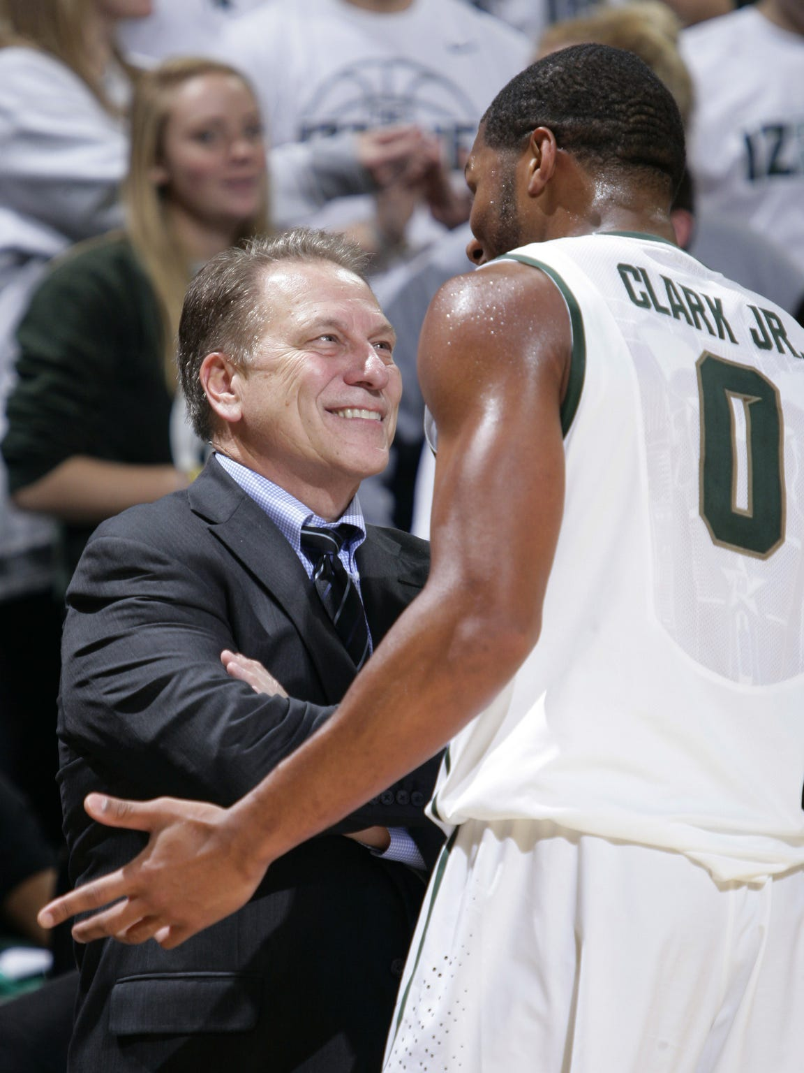 Michigan State coach Tom Izzo, left, talks with Marvin