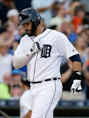 Detroit Tigers' J.D. Martinez celebrates his two-run home run against the Boston Red Sox during the second inning of a baseball game Friday, Aug. 19, 2016, in Detroit.