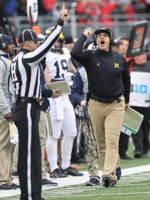 Michigan Wolverines head coach Jim Harbaugh protests a call during the second half against Ohio State on Saturday, Nov. 26, 2016 at Ohio Stadium in Columbus, Ohio.
