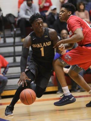 Oakland guard Kendrick Nunn drives against Detroit Mercy guard Kameron Chatman during the first half Saturday, Jan. 20, 2018 at Calihan Hall in Detroit.