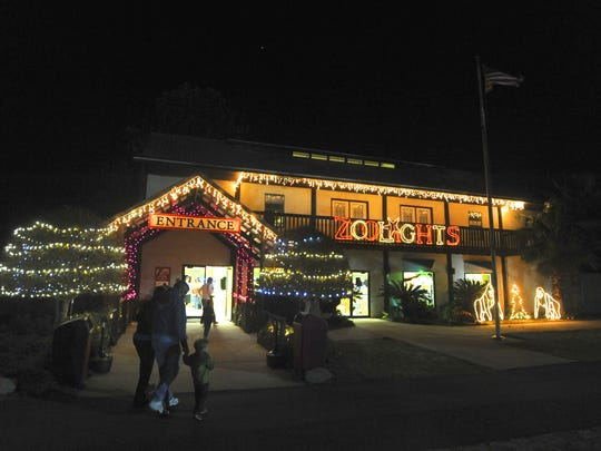 Visitors make their way into the zoo for the Zoolights display at the Gulf Breeze Zoo in this file photo. Zoolights are back at the zoo daily through Dec. 29.