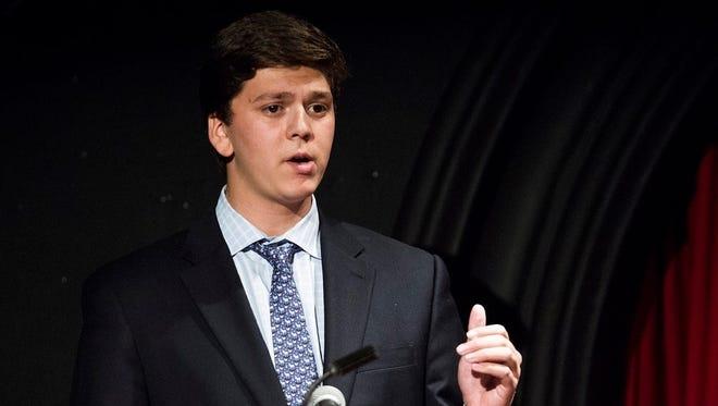 Alex DiLalla representing the University of Chicago College Democrats in a debate.