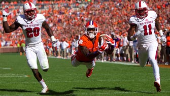 Clemson wide receiver makes a diving catch against N.C. State during the 2014 season, when he had 1,030 receiving yards.
