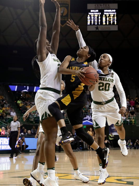 Baylor center Kalani Brown (21) and Juicy Landrum (20) defend against a shot by Grambling State guard Shakyla Hill (5) in the first half of a first-round game at the NCAA women's college basketball tournament in Waco, Texas, Friday, March 16, 2018. (AP Photo/Tony Gutierrez)