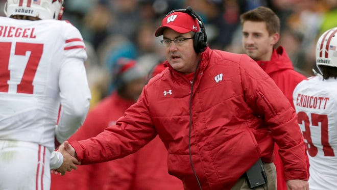 Badgers head coach Paul Chryst celebrates with his players during Wisconsin's victory over Purdue.