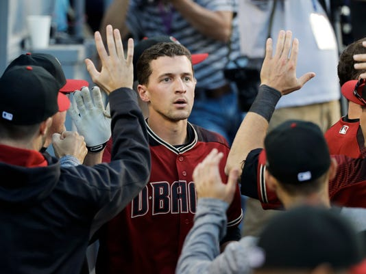 Arizona Diamondbacks' Nick Ahmed, center, is congratulated by teammates in the dugout after hitting a three-run home run during the second inning of a baseball game against the Los Angeles Dodgers, Saturday, April 15, 2017, in Los Angeles. (AP Photo/Jae C. Hong)