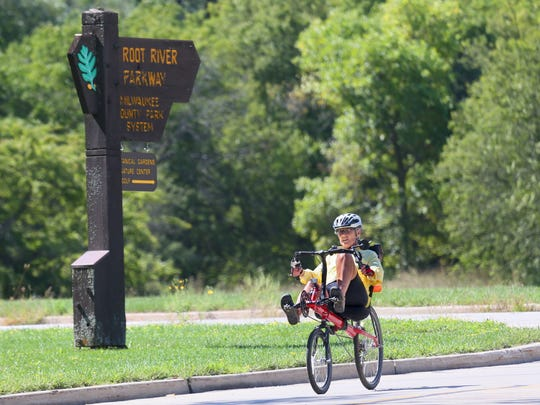 Susan Cowan of Conyers, Ga., enjoys the Root River Parkway along the Oak Leaf Trail.