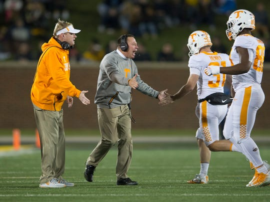 Tennessee Head Coach Butch Jones and Coach Walt Wells congratulate players after a point during a game between Tennessee and Missouri at Faurot Field in Columbia, Missouri, on Saturday November 11, 2017.