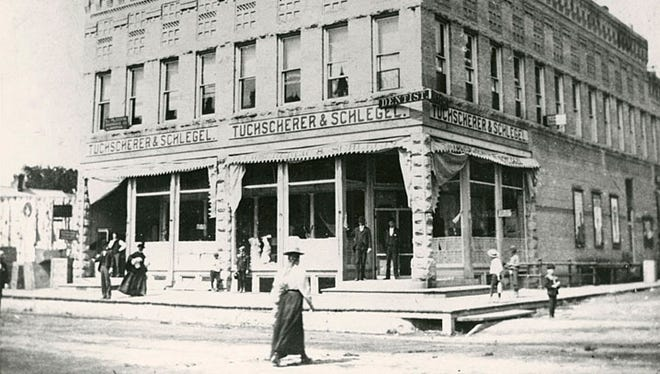 The Tuchscherer & Schlegel Department Store was located on the corner of Chute and Milwaukee streets in Menasha. It was established in 1896 and was eventually converted into a theater. The building no longer exists.