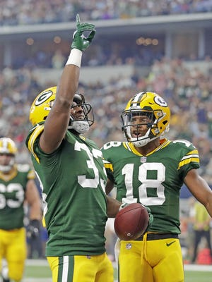 Green Bay Packers running back Aaron Jones (33) celebrates his second quarter touchdown with wide receiver Randall Cobb (18) against the Dallas Cowboys Sunday, October 8, 2017 at AT&T Stadium in Arlington, Tx.