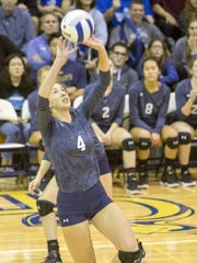 IHA #4 Julia Morris returns a volley during the  best-of-three championship of the 43rd Bergen County girls volleyball tournament  between IHA and Demarest HS on Sunday, Oct. 29, 2017.