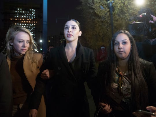 "File image shows Emma Coronel Aispuro, center, the wife of Joaquin ""El Chapo"" Guzman, leaving Brooklyn federal court after opening arguments in the trial of the accused Mexican drug lord known on Nov. 13, 2018."