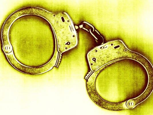 ASBBrd_02-19-2013_PressMon_1_A001~~2013~02~18~IMG_handcuffs.jpg_1_1_4C3EGCED