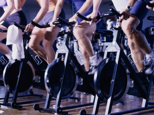 Group of people exercising in a health club