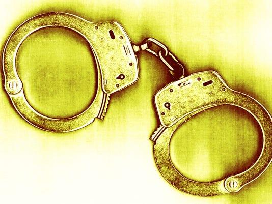IMG_handcuffs.jpg_1_1_4C3EGCED.jpg_20130219.jpg